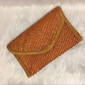 Vintage tan woven envelope style clutch